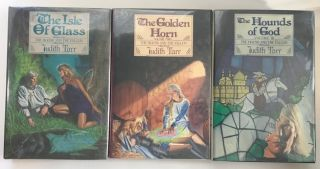 The Hound and the Falcon Trilogy: The Isle of Glass; The Golden Horn; The Hounds of God. Judith Tarr